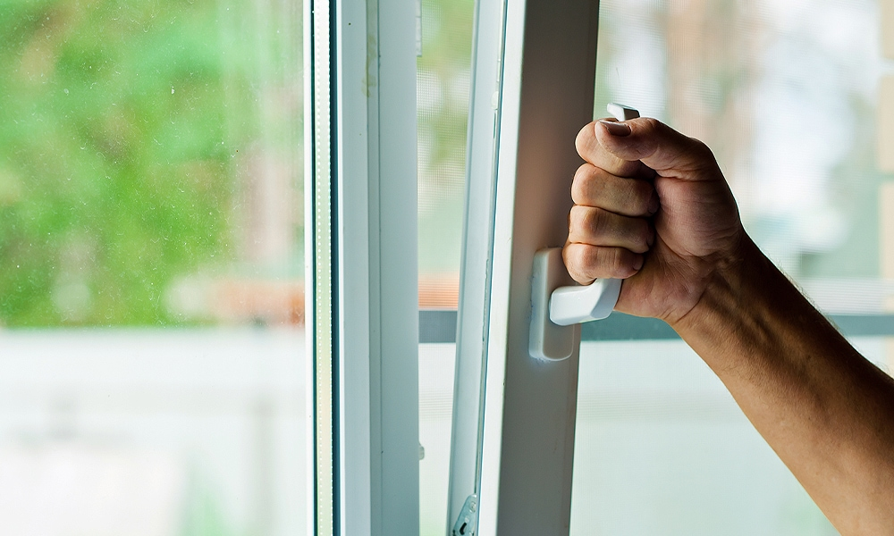hand opening a window