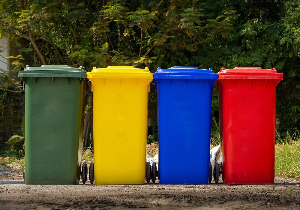 four colorful trashbins