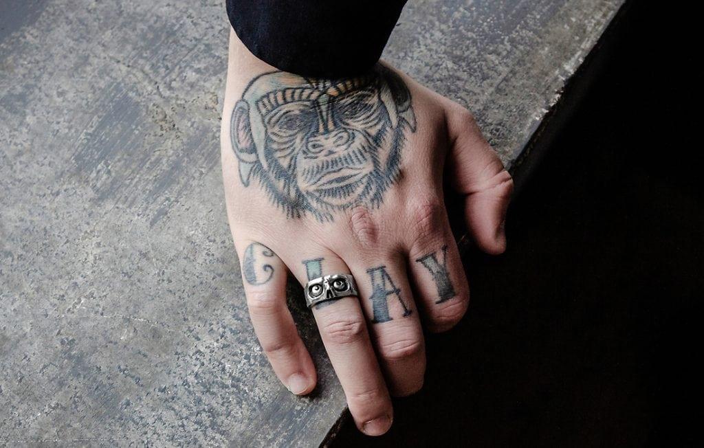 monkey tattoo on a hand